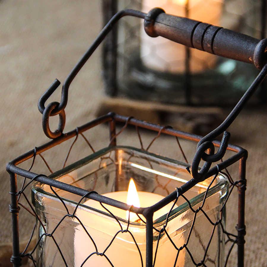 ที่วางเทียนเหล็กRetroเทียนแท่งเทียนโคมไฟแจกันเทียนHollowตกแต่งคริสต์มาสBougeoirลมโคมไฟFC194