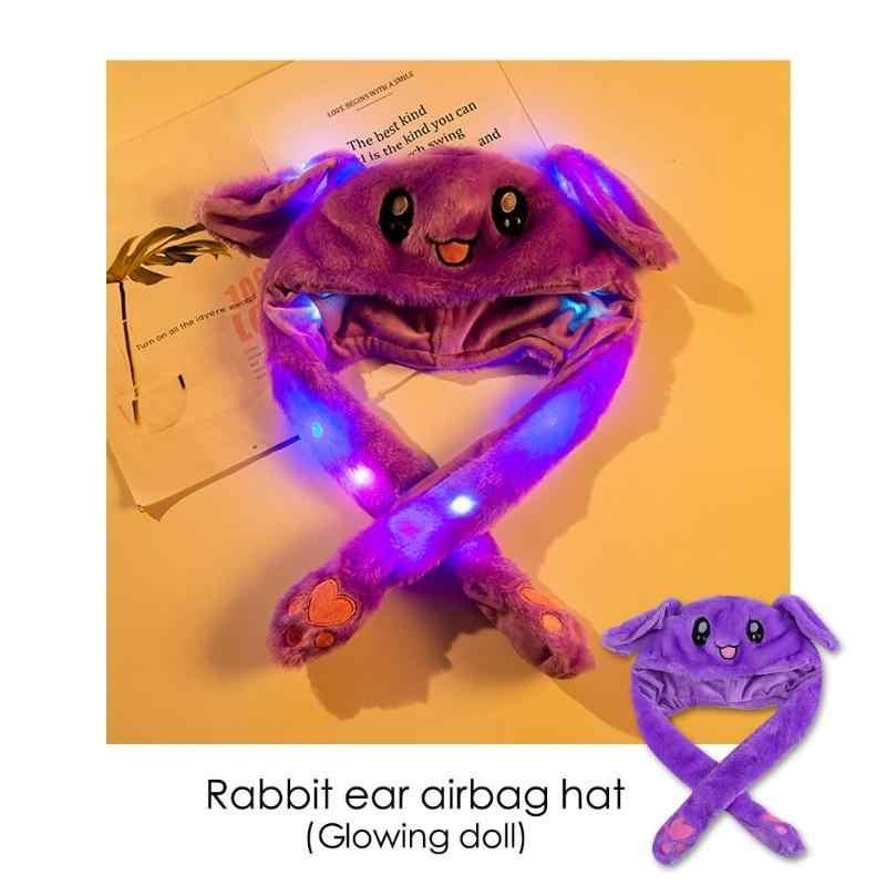 Divertido conejo orejas Airbag juguete sombrero pellizcar orejas se moverá juguete luminoso