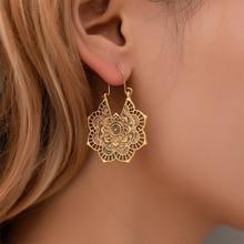 купить New Fashion Women Earrings Exquisite Retro Metal Hollow Flower Drop Earrings Bohemian Carved Dangle Earrings Party Jewelry WD571 по цене 62.53 рублей