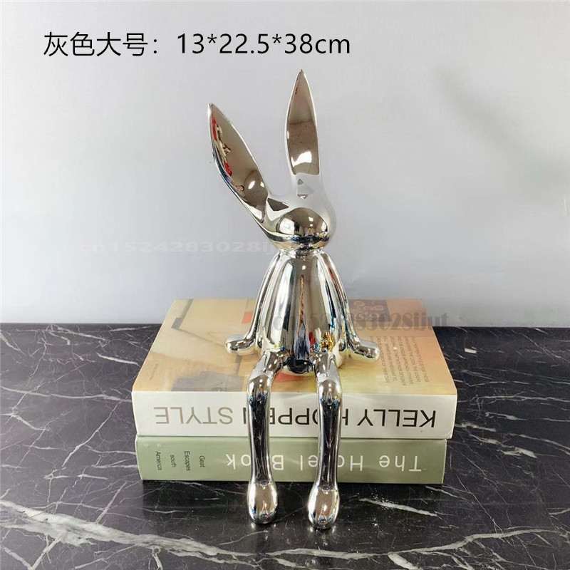 Criativo galvanoplastia prata ouro azul sentado coelho