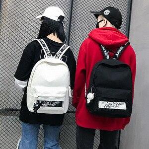Image 2 - חדש תרמיל אופנה בד נשים תרמיל בובת תליון נסיעות נשים כתף תיק Harajuku תרמיל נשי בית ספר שקיות