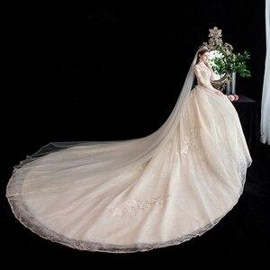 Image 4 - Moda elegancka suknia ślubna na szyję luksusowe koronki muzułmańska suknia ślubna 2020 nowy szampan długi pociąg aplikacja księżniczka Brida Robe De Mariee