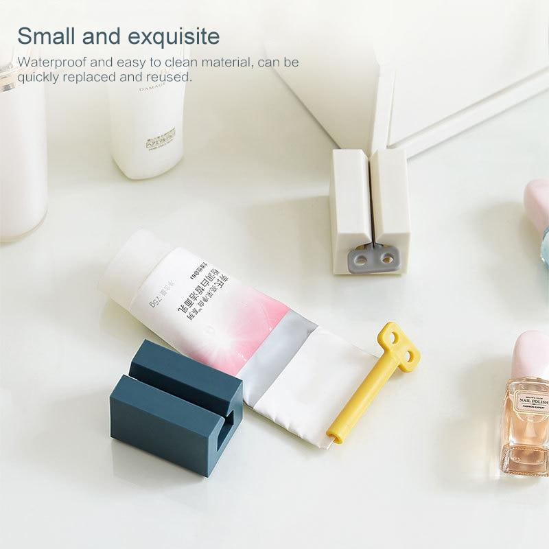 1PCS Multi-function Bathroom Plastic Tube Squeezing Dispenser Rolling Tube Stand Holder Squeezer Toothpaste Squeezer Dispenser