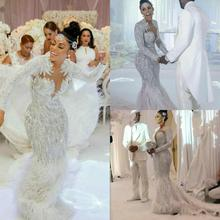 Charbel זואי אלי סאאב Yousef alijasmi בת ים חתונת שמלות 2020 ארוך שרוול לבן נוצת כלה שמלת ללכת זוהיר קיילי ג נר