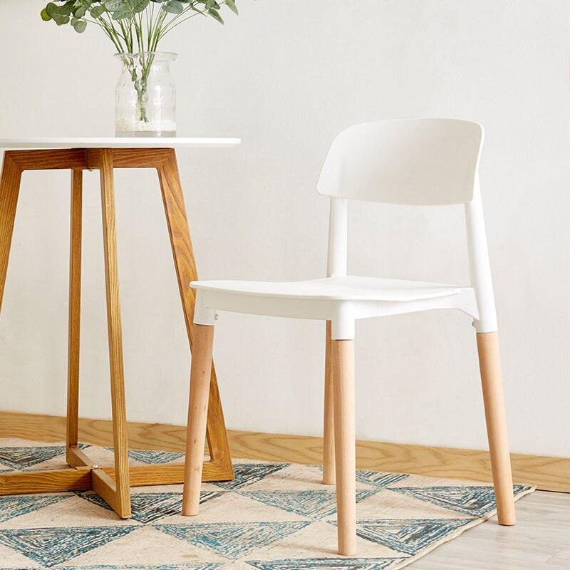 Chaises en plastique en bois massif de mode nordique dinant des chaises pour des salles à manger