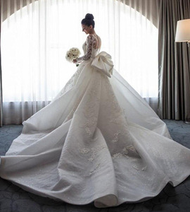 Image 3 - 2020 Luxury Mermaid Wedding Dresses Sheer Neck Long Sleeves Illusion Full Lace Applique Bow Overskirts Button Back Chapel Train