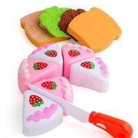 Los niños juegan a la casa juguete para torta de cumpleaños rebanadora de frutas Emulational