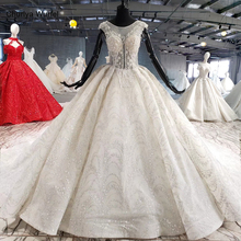 HTL1002 高級ウェディングドレス自由奔放に生きるイリュージョン o ネックノースリーブボタンバックアップリケ花嫁のウェディングドレス新デザインローブ · デ · マリアージュ