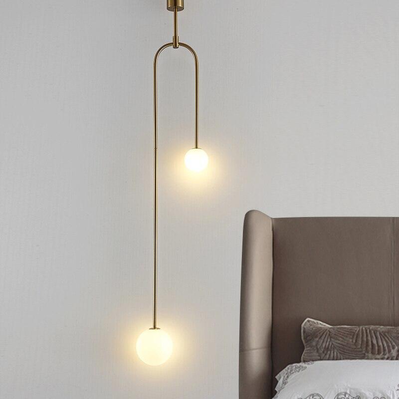 Işıklar ve Aydınlatma'ten Kolye ışıkları'de Post modern sanat askılı restoran lambası İskandinav basit yemek masası başucu yatak üç yuvarlak demir Cosmos kolye ışıkları lampen title=