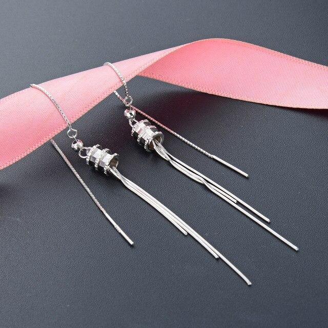 Фото японские и корейские темпераментные длинные серьги из чистого