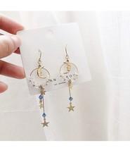 Sen Xingyue girl ins earrings super fairy crystal long asymmetric net red Korean small fresh ear jewelry