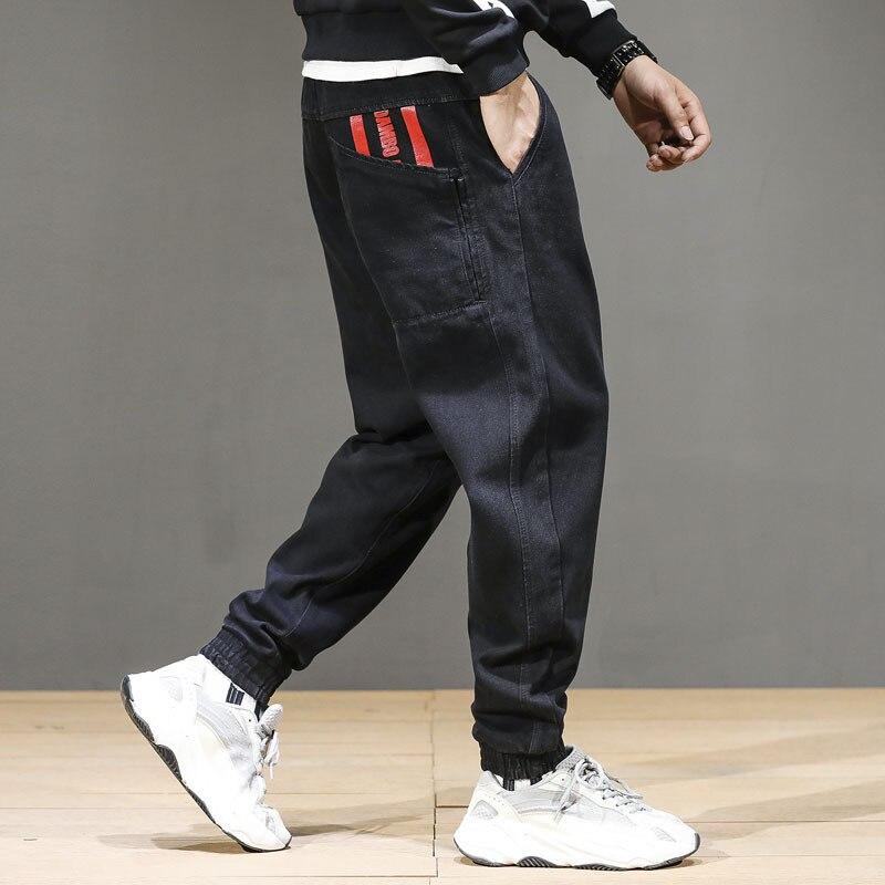 Fashion Streetwear Men Jeans Loose Fit Black Color Spliced Cargo Pants Harem Jeans Size 28-42 Designer Hip Hop Jeans Men Joggers