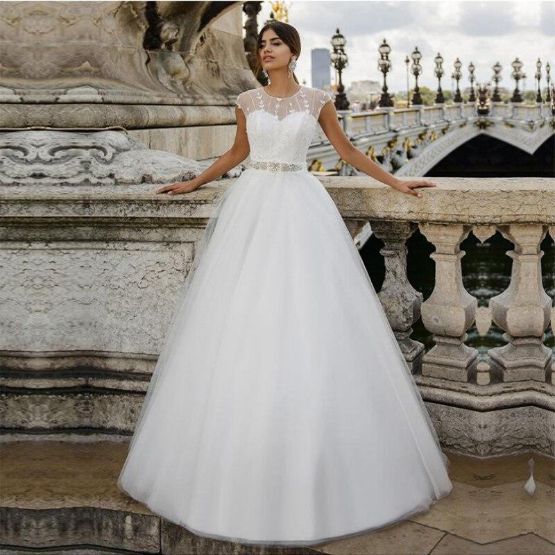 Perlée à la main fleurs robes de mariée a-ligne robes de mariée Cap manches Vestido de Noiva sur mesure robe de bal longueur de plancher