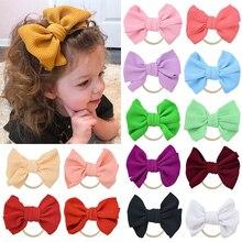 все цены на Cute bow knot hairband stretch headband girls candy color rubber band Toddler Turban Head Wrap newborn wedding hair accessories онлайн