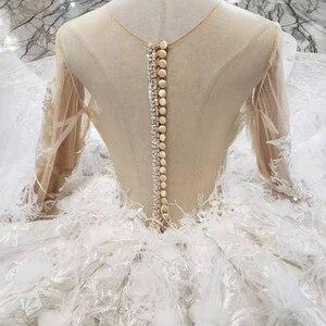 Image 5 - BGW HT4304 specjalne suknie ślubne z piórkiem przezroczyste plecy ręcznie robiony guzik suknia ślubna dla dziewczynki Vestido De Noiva Princesa