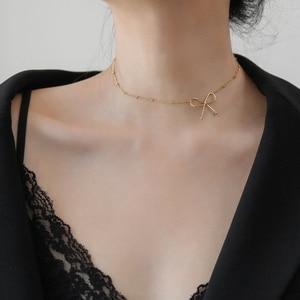 Юнь РУО тренд 14 К золото лук ожерелье короткая цепочка Женская мода Элегантный титановая сталь ювелирные изделия подарок никогда не выцвет...