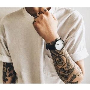 Image 5 - 탑 크리 에이 티브 디자이너 브랜드 쿼츠 시계 남성 가죽 캐주얼 남여 간단한 손목 시계 시계 남성 선물 relogio Masculino