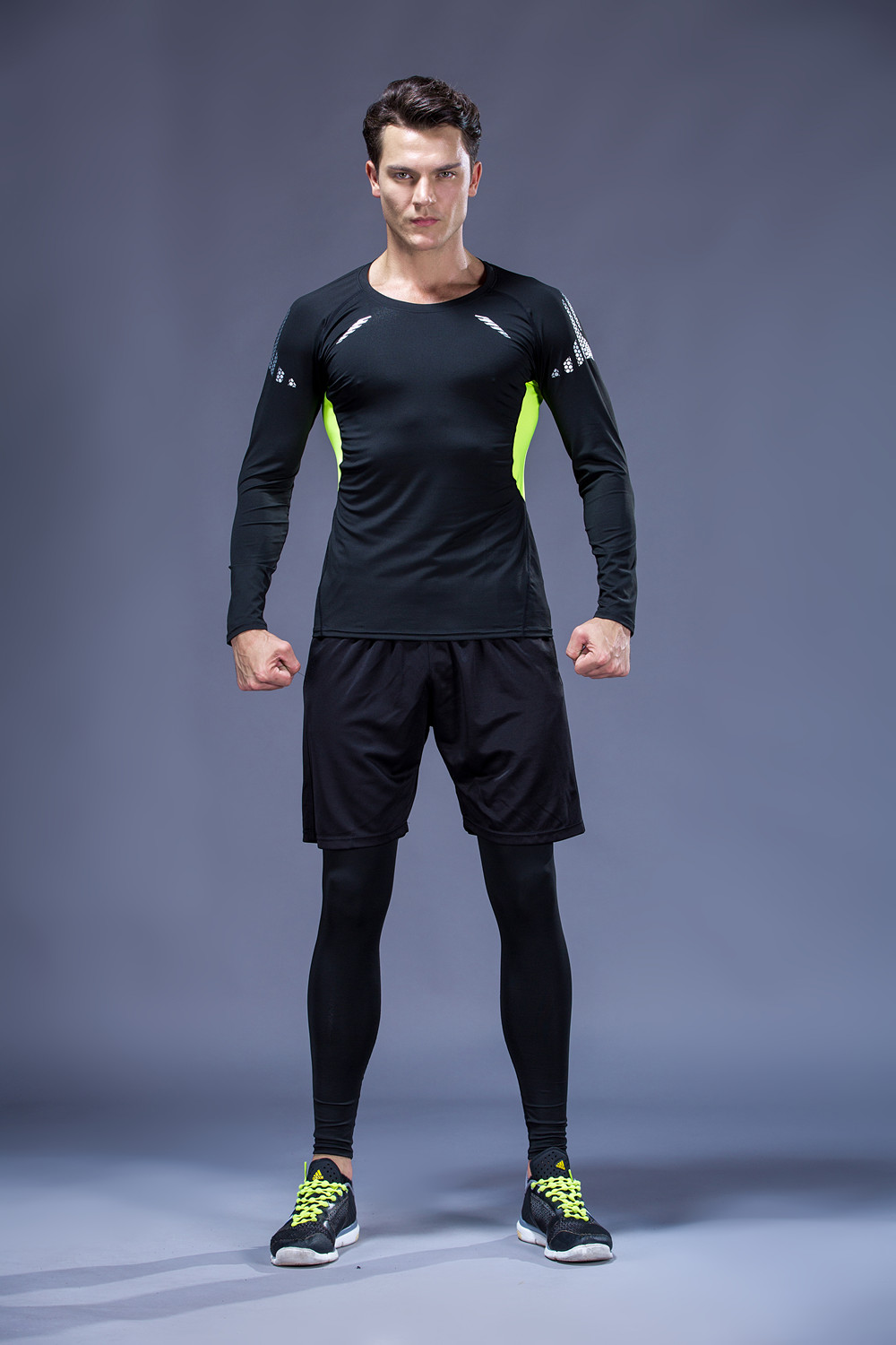 Foto from the front on men 5 pcs compressions clothes for gym. Men's 5 pcs compression tracksuit sports