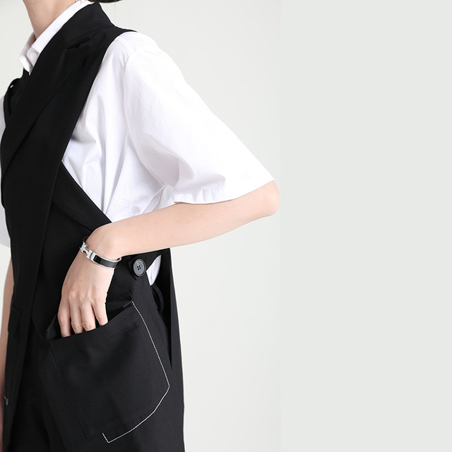 [EAM] Women Loose Fit Black Cross Spliced Irregular Long Vest New Lapel Sleeveless Fashion Tide Spring Summer 2021 1DD9297 2