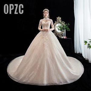 Image 1 - Moda elegancka suknia ślubna na szyję luksusowe koronki muzułmańska suknia ślubna 2020 nowy szampan długi pociąg aplikacja księżniczka Brida Robe De Mariee
