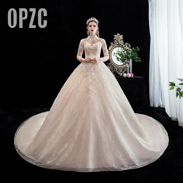 Moda elegancka suknia ślubna na szyję luksusowe koronki muzułmańska suknia ślubna 2020 nowy szampan długi pociąg aplikacja księżniczka Brida Robe De Mariee