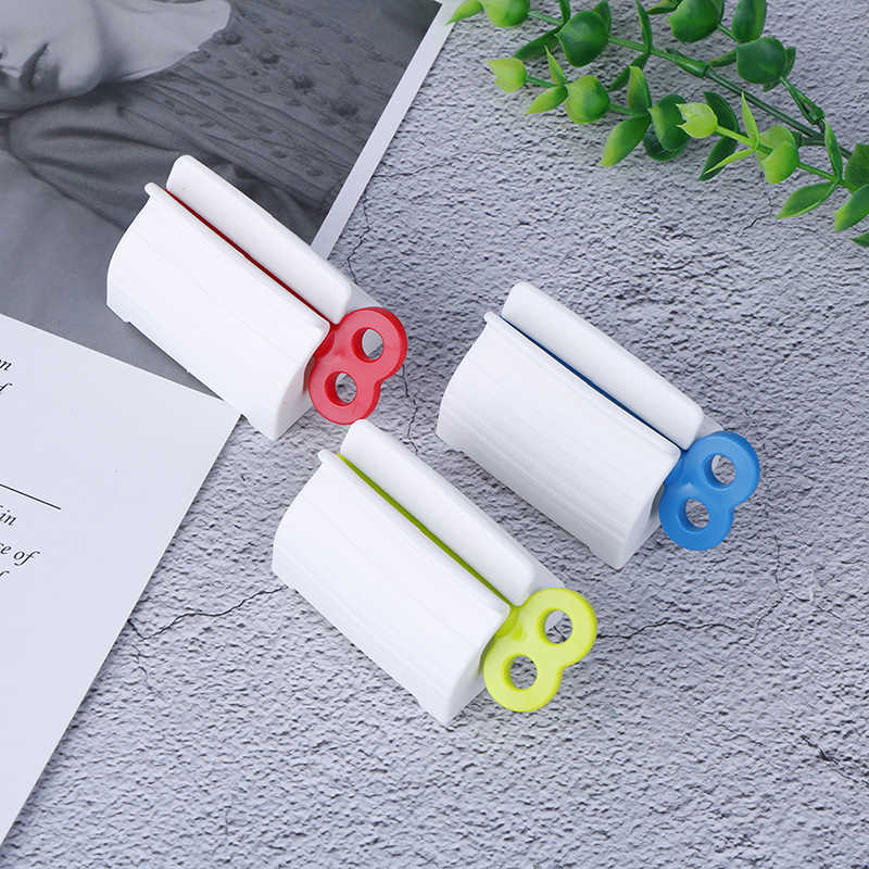 Plastic Rolling Tube Toothpaste Seat Holder Rotate Bathroom Rotate Squeezer KQ