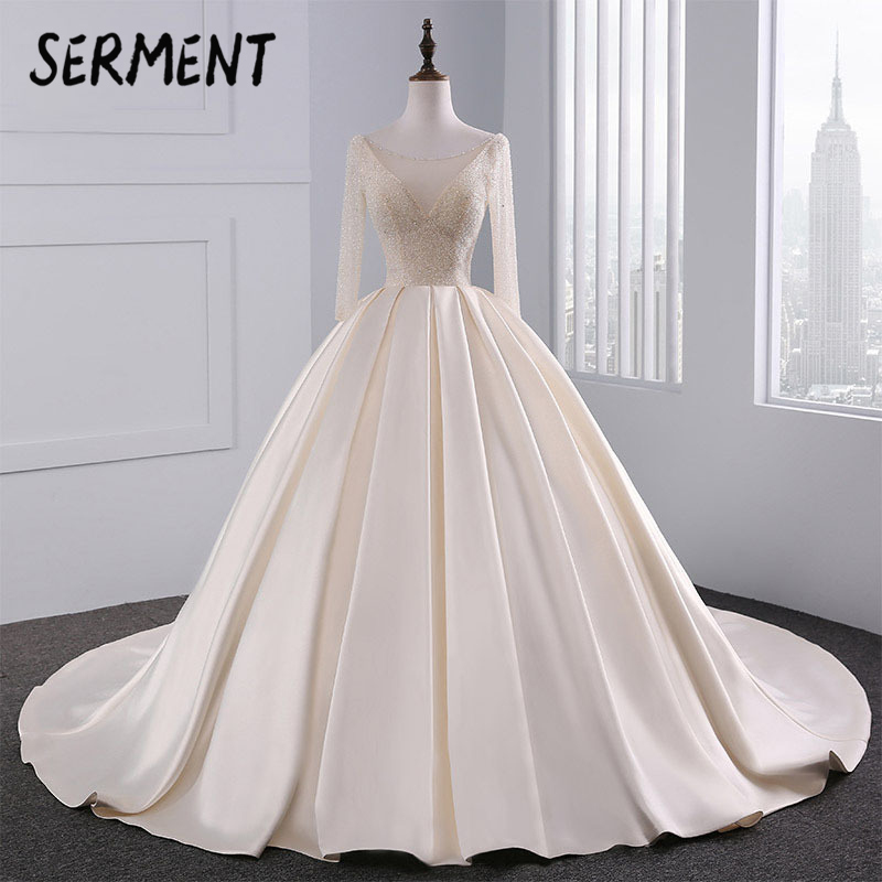 SERMENT Satin Bride Princess Wedding Dress 2019 Luxury Light Champagne Hand-drilled Long-sleeved Sexy Spring Summer Small Tail