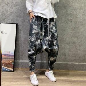 Pantalones de harén holgados de camuflaje estilo japonés pantalones de cintura elástica para mujer