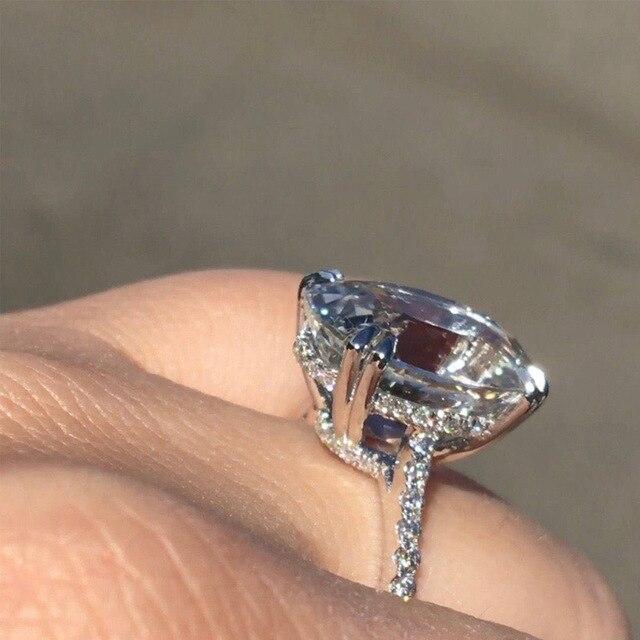 Фото женские кольца серебряного цвета с большим овальным цирконием