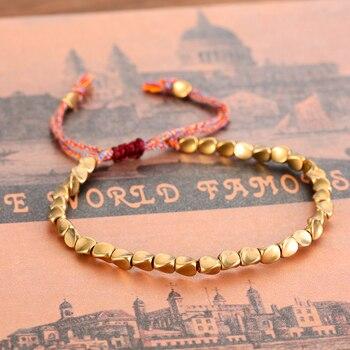 Bracelet de corde chanceux tib tain fait la main avec des perles de cuivre pour les