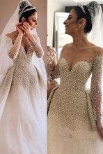 New Arrival eleganckie długie rękawy Sweetheart suknia ślubna 2019 perły Overskirt suknia ślubna Illusion szyi turcji