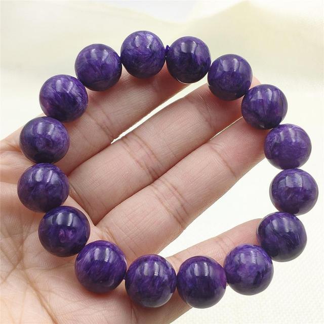 Фото бусины шармы из натурального фиолетового хароитного браслета