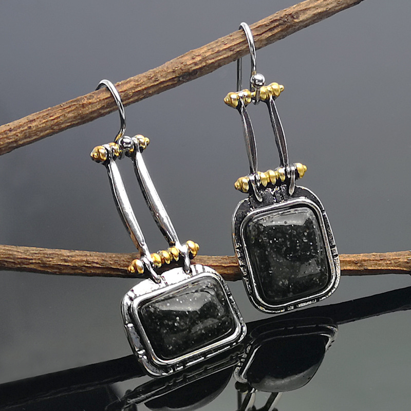 C163 earrings
