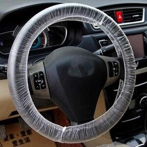 Image 4 - أغطية مقاعد السيارة البلاستيكية الناعمة التي يمكن التخلص منها ، مجموعة من 50 أو 100 أغطية مقاومة للماء لأغطية عجلات القيادة التي يمكن التخلص منها
