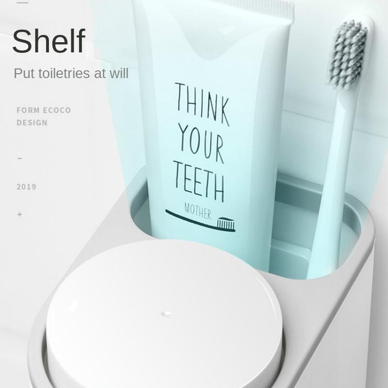 escova copo pendurado parede vaso sanitário lugar