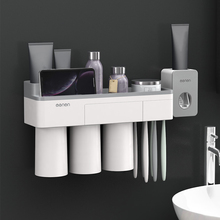 מברשת שיניים משחת שיניים מחזיק אוטומטי משחת שיניים Dispenser מסחטת אמבטיה מתלה צינור מסחטת שיווק מוצרים