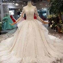 LS11016 nouveau design robes de mariée 2020 illusion o cou à manches longues en tulle grand nœud robe de mariée avec train brillant chine en gros