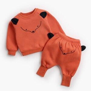 Image 4 - דוב מנהיג תינוק קובע חדש חורף יילוד תינוק בגדי חליפות מקרית Cartoon פנדה סוודר + מכנסיים 2pc ילדים תלבושות