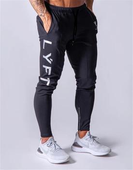 Nowe spodnie do joggingu męskie spodnie sportowe spodnie do biegania spodenki do ćwiczeń męskie biegaczy bawełniane spodnie do biegania dopasowane obcisłe spodnie kulturystyka spodnie tanie i dobre opinie ENJPOWER Ołówek spodnie Na co dzień Elastyczny pas Mieszkanie Pełnej długości Poliester COTTON REGULAR 2 2 - 3 6 Midweight