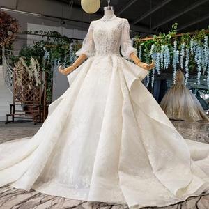 Image 3 - HTL984 boho weselny strój koronki pół rękawa latarnia koronki na szyję dziurka od klucza powrót luksusowe suknie ślubne wzburzyć pociąg vestido boda