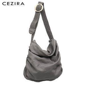 Image 1 - Большая мягкая повседневная женская сумка CEZIRA, школьная сумка из искусственной кожи для девушек, сумка мессенджер с регулируемой плетеной пряжкой и плечевым ремнем