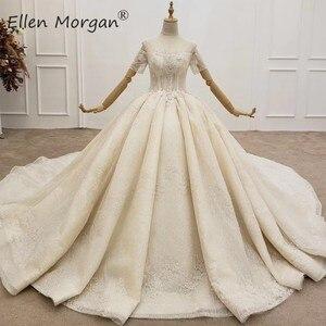 Image 1 - יוקרה ארוך שרוולי כדור שמלות חתונה שמלות Sheer צוואר תחרה פניני חרוזים סעודית אלגנטי עבור כלה 2020
