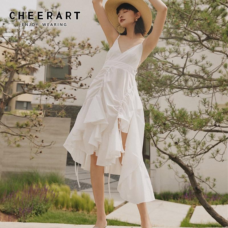 Cheerart blanc Spaghetti sangle jarretelle robe femmes dos nu col en V Rregular robe asymétrique à volants robe haute rue