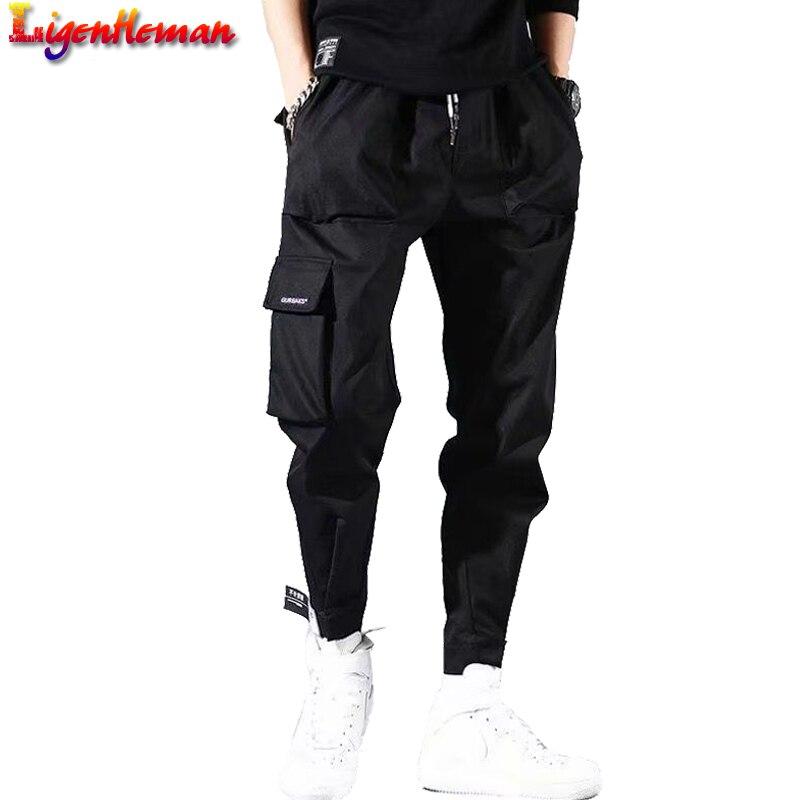 Men Hip Hop Trousers Streetwear Black Harem Pants Men Elastic Waist Punk Pants With Ribbons Casual Slim Jogger Pants HA6930