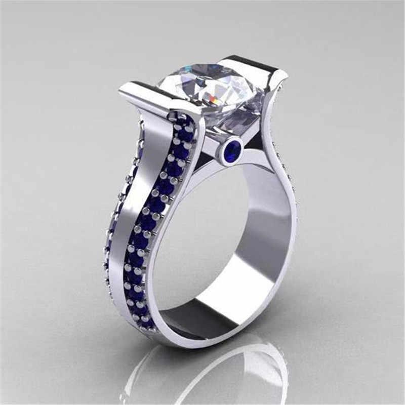 Modyle 2019 חדש עיצוב יוקרה לבן זהב צבע גדול עגול CZ אבן חתונה טבעת לאישה עם קטן כחול זירקון עגול מתנות