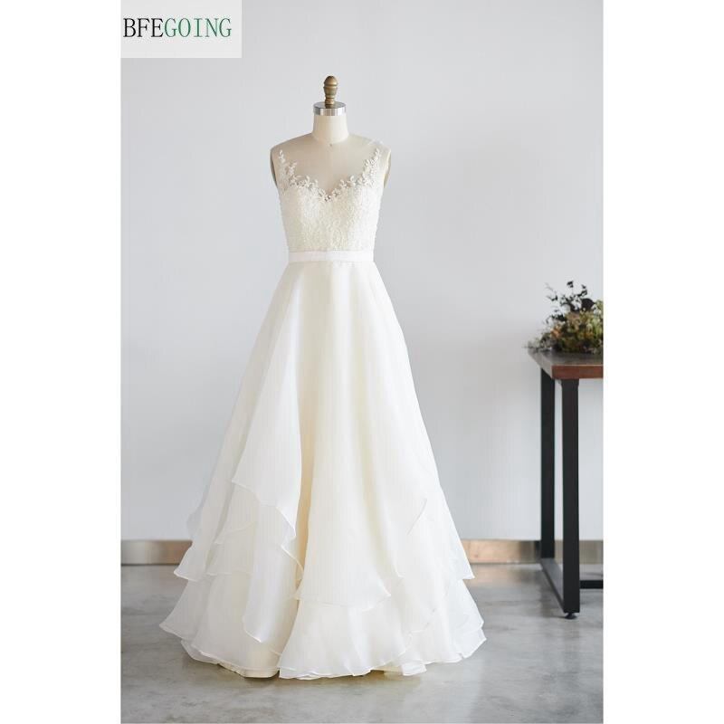 Ivoire dentelle Organza perles Scoop sans manches longueur au sol a-ligne robe de mariée sur mesure
