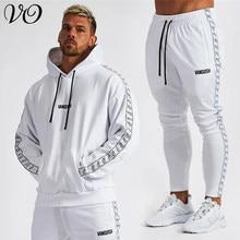 Wiosenna i jesienna nowa moda męska odzież fitnessowe bawełniane garnitur luźny pulower bluza z kapturem haftowane męskie spodnie