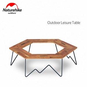 Image 1 - Naturehike mesa de Camping con Panel de madera y soporte de hierro, mesa de acampada Hexagonal, fácil montaje, pícnic familiar al aire libre, barbacoa de viaje, 2019