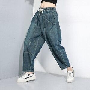 Image 2 - [EAM] 높은 탄성 스플 라이스 포켓 데님 허리 바지 새로운 느슨한 맞는 하렘 바지 여성 패션 조수 봄 가을 2020 1B694
