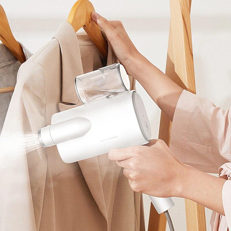 Le vapeur portatif tenu dans la main de vêtement de ménage de vapeur de fer vêtements le DEM-HS006 électrique Commercial d'artefact de vêtements de Machine de fer